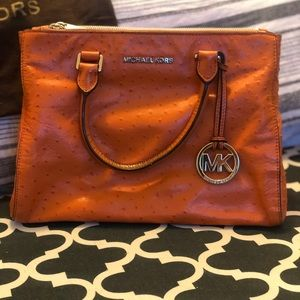 2011 Michael Kors bag. Lots of pockets.